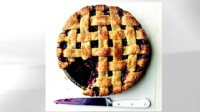 Lattice-top blueberry pie is shown.