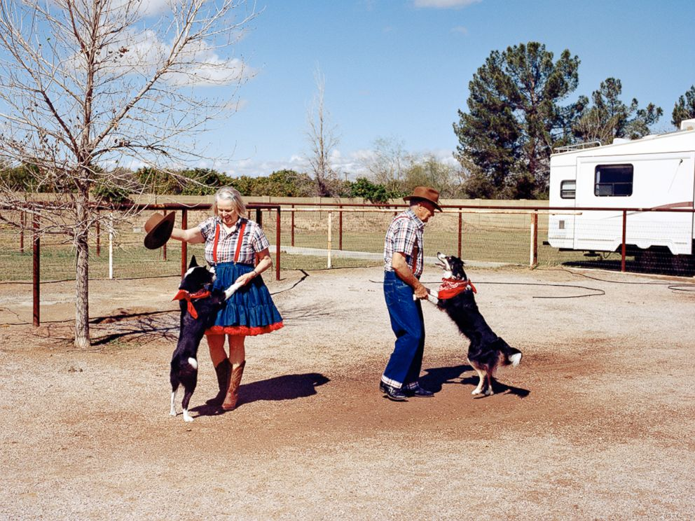 PHOTO:Sandy and Jerry dance with their dogs, Bliss and Diva in Phoenix, Ariz.
