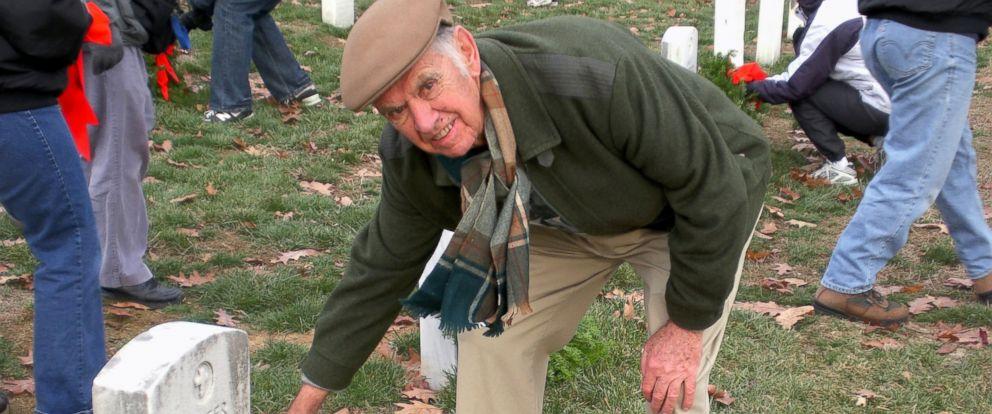 PHOTO: World War II Kenneth Spilman lays a wreath on a veterans grave in Arlington National Cemetery.