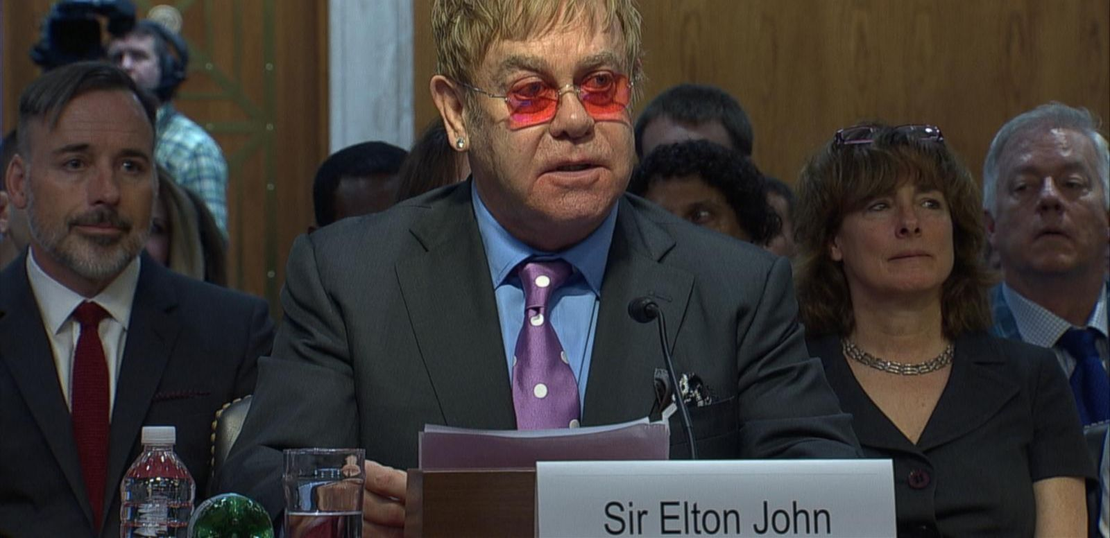 VIDEO: The Rocket Man tells senators he thinks AIDS can be eradicated in his lifetime.
