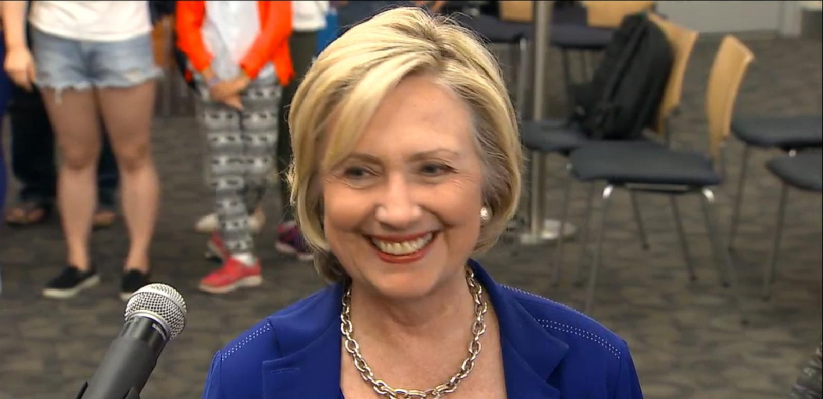 VIDEO: In Iowa, Clinton jokes with reporters about the rope used to corral reporters at 4th of July parade.