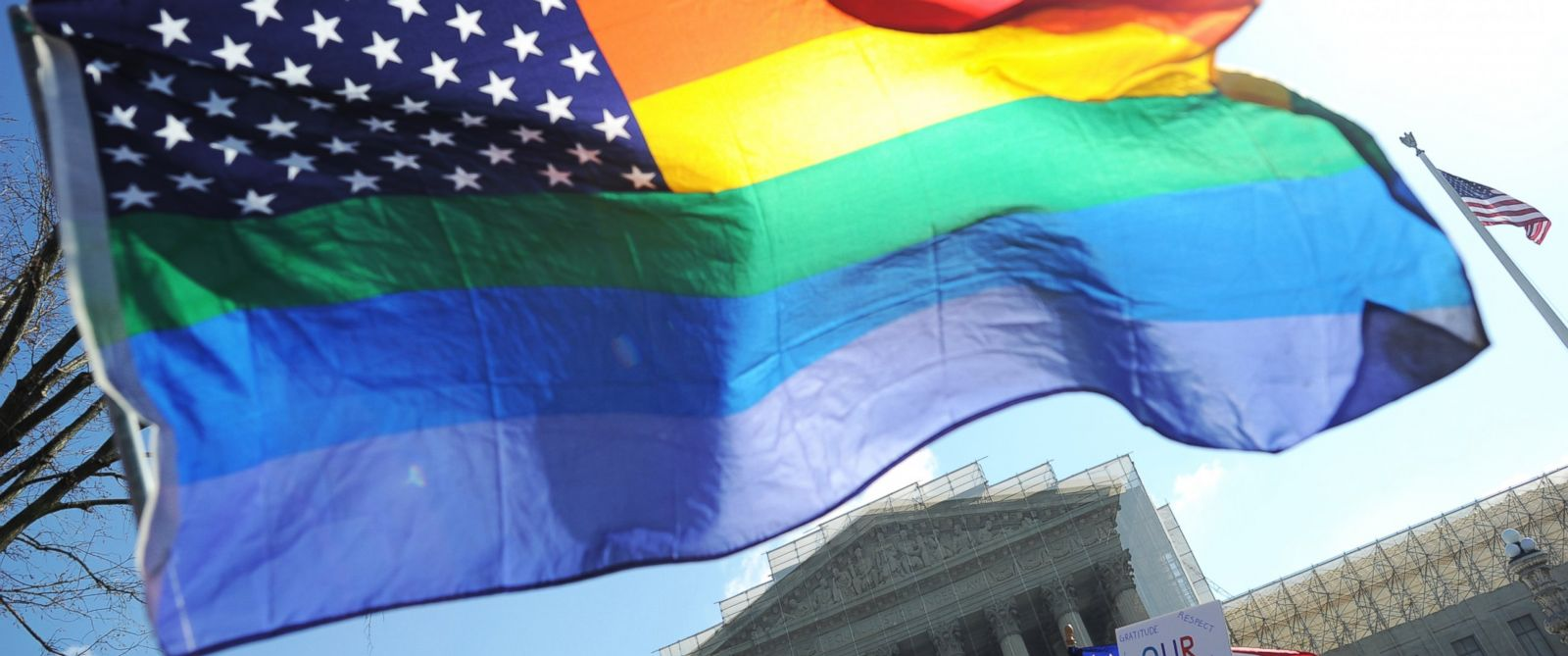 PHOTO: Same-sex marriage supporters wave a rainbow flag in front of the US Supreme Court, March 26, 2013 in Washington.