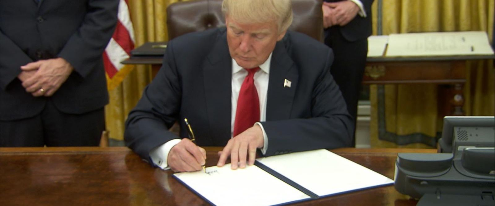 President Trump signs executive orders on his first night in the Oval Office.