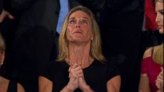 The wife of William Ryan Owens was overcome with emotion as Trump said Owens memory will forever be etched into eternity.