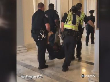 WATCH:  Protesters dragged away from Sen. McConnell's office