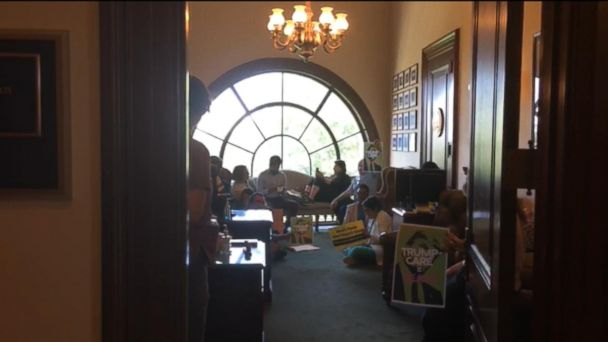 VIDEO: Protesters rally against proposed health care bill inside Sen. Rob Portman's office