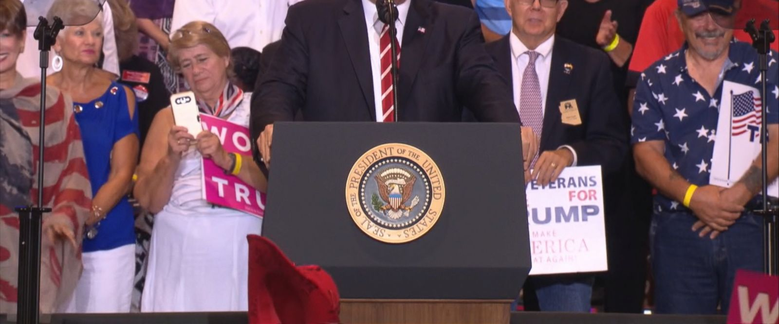 Trump said the media was to blame for the negative response to his response to Charlotteville, Virginia, while implying he would pardon Sheriff Joe Arpaio and vowing to continue efforts to reform health care at a campaign rally.