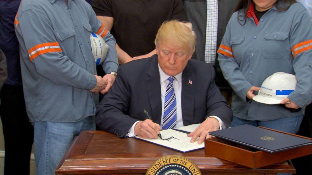 Trump defies critics, makes steel and aluminum tariffs official