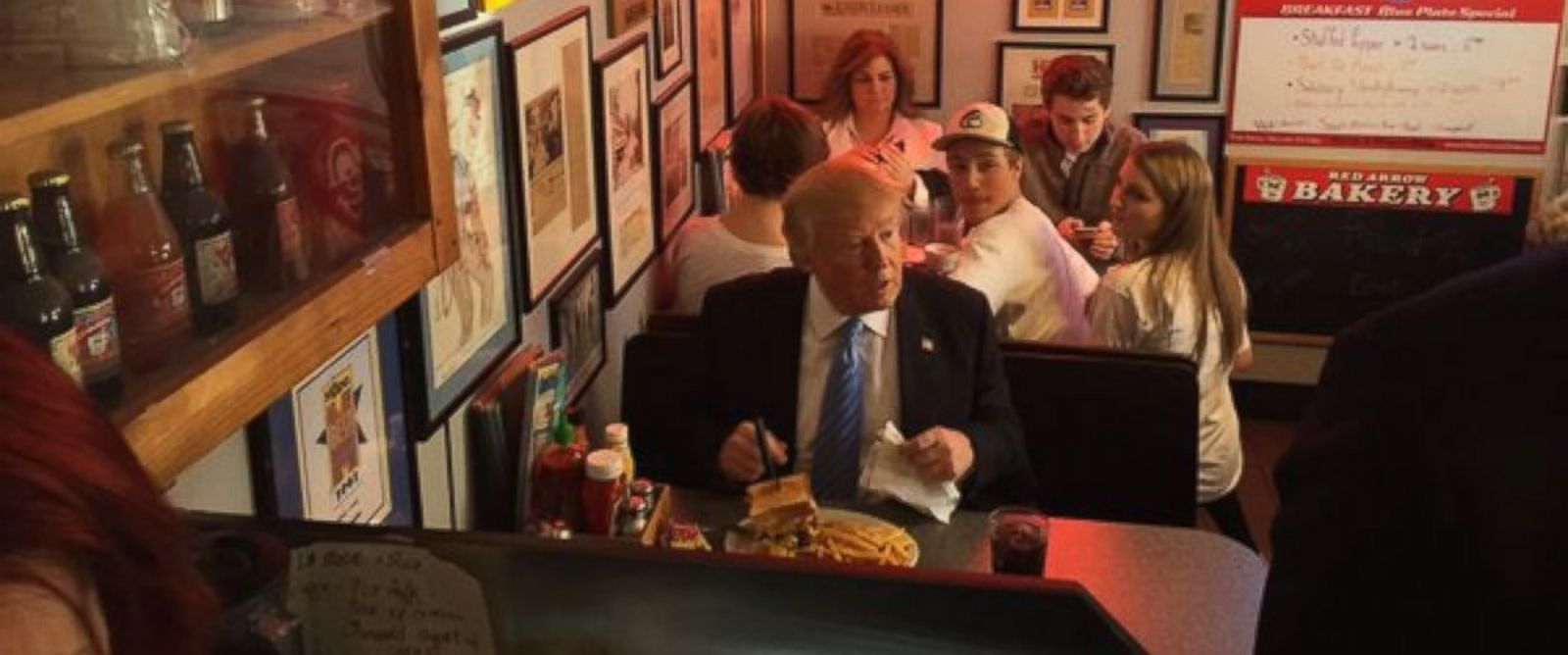 PHOTO: In his first real NH retail stop, Donald Trump ordered a burger at the famous Red Arrow Diner.