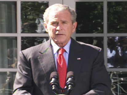 pic of george bush after passage of the house bailout bill