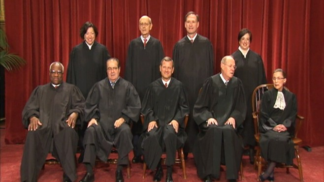 Video of Supreme Court justices posing for photo.
