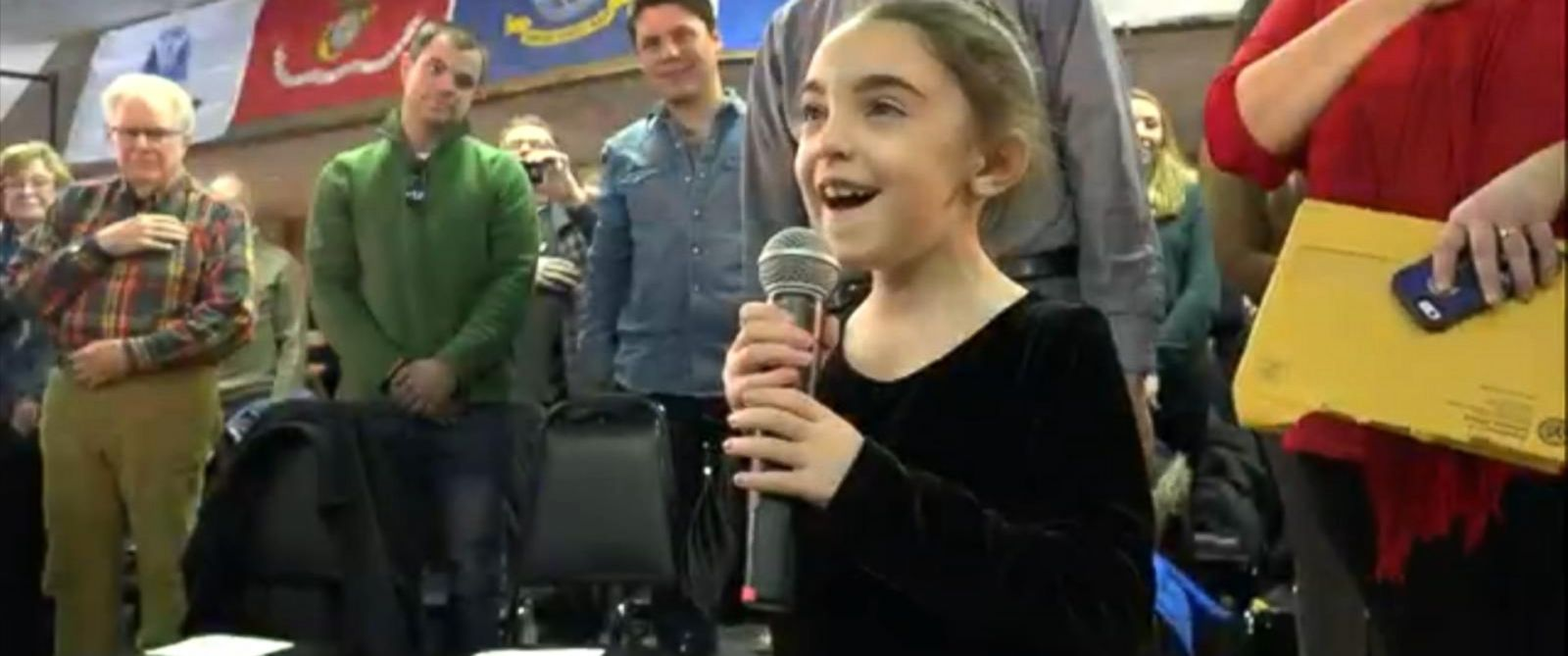 PHOTO:Sienna Szarek, 7, sings the National Anthem at the beginning of nearly every town hall meeting New Jersey Gov Chris Christie holds in New Hampshire.