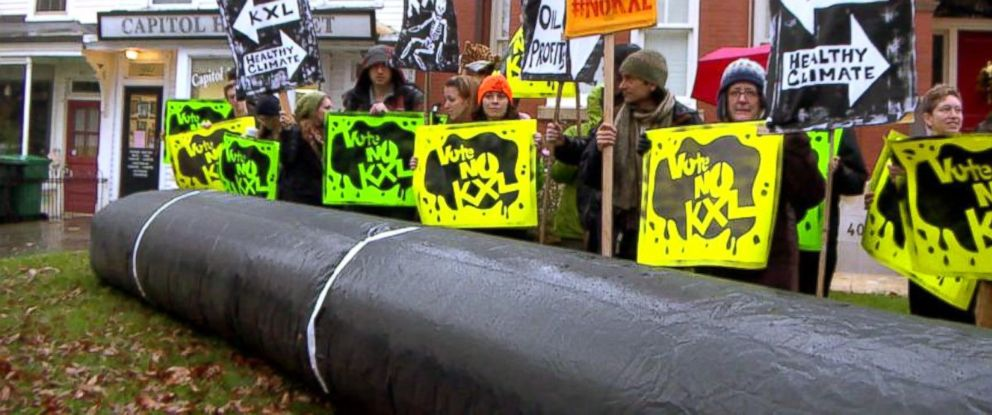 PHOTO: Activists placed a 30 foot long inflatable pipeline outside Sen. Mary Landrieus Washington, D.C. home in protests against the Keystone XL pipeline.