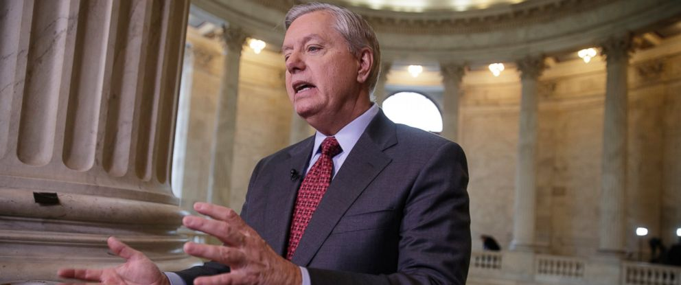 PHOTO: Sen. Lindsey Graham, R-S.C., a member of the Armed Services Committee and the Judiciary Committee, responds during a TV news interview to a question about President Donald Trumps administration.