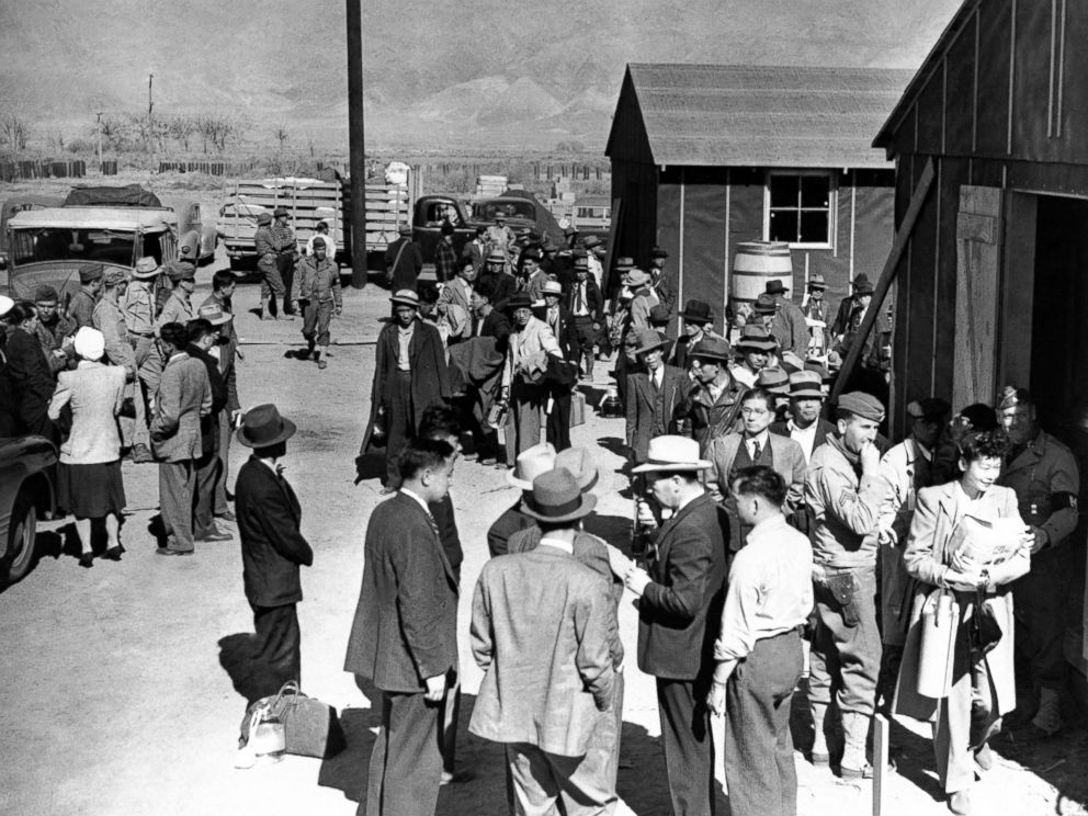 PHOTO: First arrivals at the Japanese evacuee community established in the owens valley at Manzanar, California, March 23, 1942, part of a vanguard of 86 workers from Los Angeles, are assigned to quarters in the barracks.