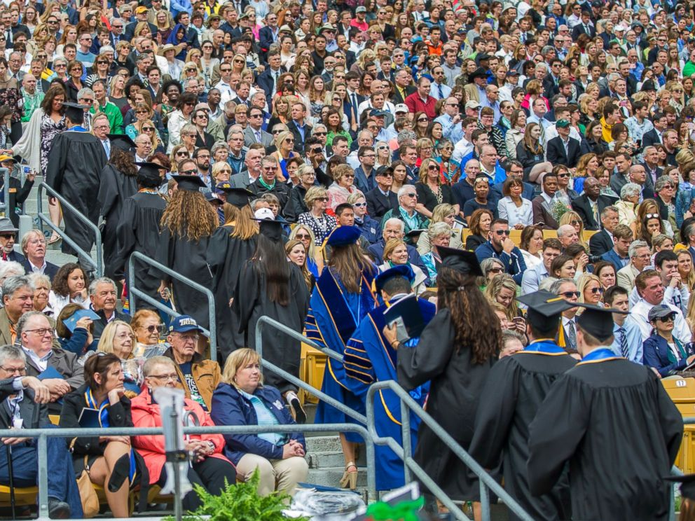 PHOTO: Notre Dame graduates walk out of Notre Dame Stadium in protest as Vice President Mike Pence speaks during the 2017 commencement ceremony, May 21, 2017, in South Bend, Ind.