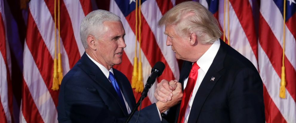 PHOTO: President-elect Donald Trump shakes hands with Vice President-elect Mike Pence as he gives his acceptance speech during his election night rally, Nov. 9, 2016, in New York City.