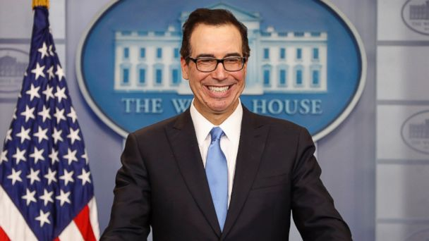 PHOTO: Treasury Secretary Steve Mnuchin smiles while speaking to the media during the daily briefing in the Brady Press Briefing Room of the White House in Washington, April 24, 2017.