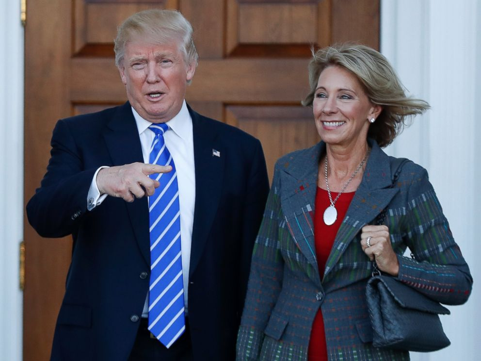 PHOTO: President-elect Donald Trump and Betsy DeVos pose for photographs at Trump National Golf Club Bedminster clubhouse in Bedminster, New Jersey, Nov. 19, 2016.