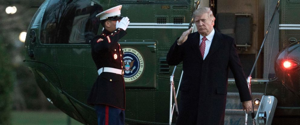 PHOTO: President Donald Trump salutes as he disembarks Marine One upon arrival at the White House, March 5, 2017, in Washington.