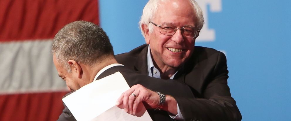 PHOTO: Sen. Bernie Sanders greets Russ Feingold, Democratic candidate for the U.S. Senate, as he enters the stage in Madison, Wisconsin, Oct. 5, 2016.