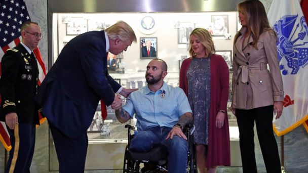 PHOTO: President Donald Trump shakes hands with U.S. Army Sgt. First Class Alvaro Barrientos, after awarding him with a Purple Heart, at Walter Reed National Military Medical Center, April 22, 2017, in Bethesda, Md.