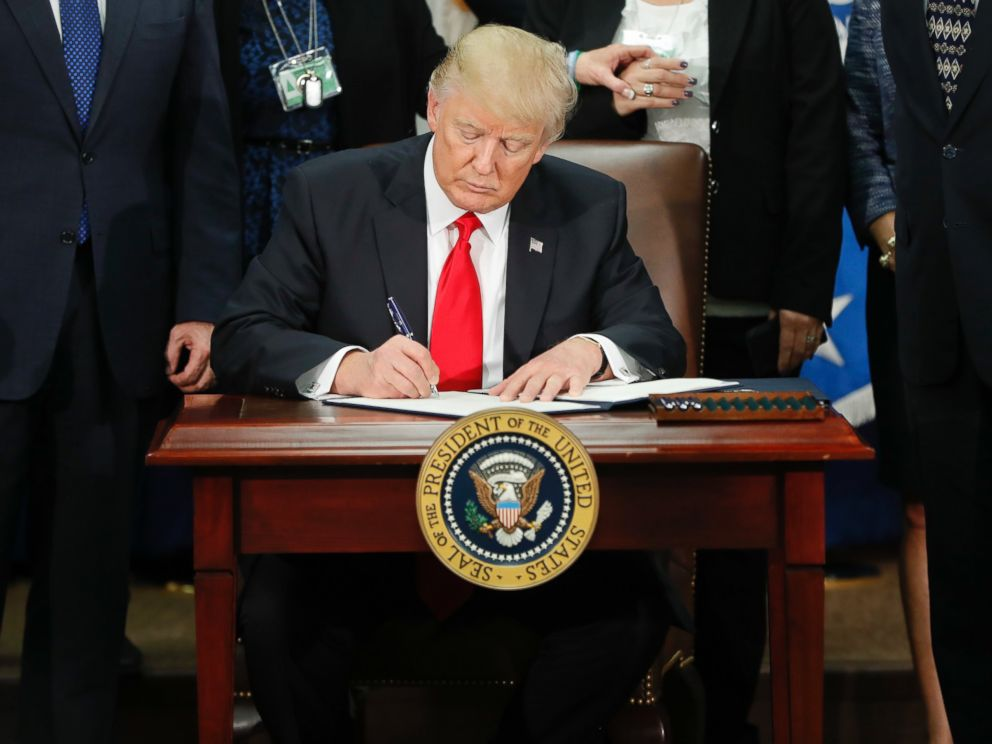 PHOTO: President Donald Trump signs an executive order for border security and immigration enforcement improvements at the Department of Homeland Security in Washington, Jan. 25, 2017.
