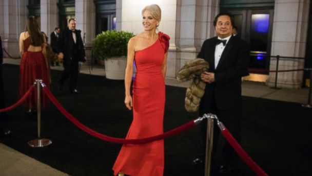 PHOTO: Kellyanne Conway, accompanied by her husband, George, speaks with members of the media as they arrive for a dinner at Union Station in Washington, the day before Trump's inauguration, Jan. 19, 2017.