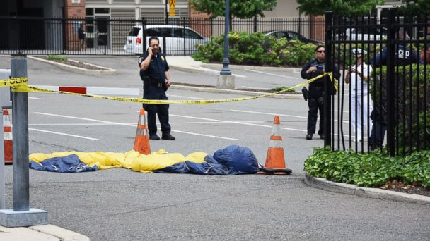 PHOTO: Officials surround a U.S. Navy Seal's parachute that landed in a parking lot after the parachutist fell into the Hudson River when his parachute failed to open during a Fleet Week demonstration over the river in Jersey City, N.J., May 28, 2017.