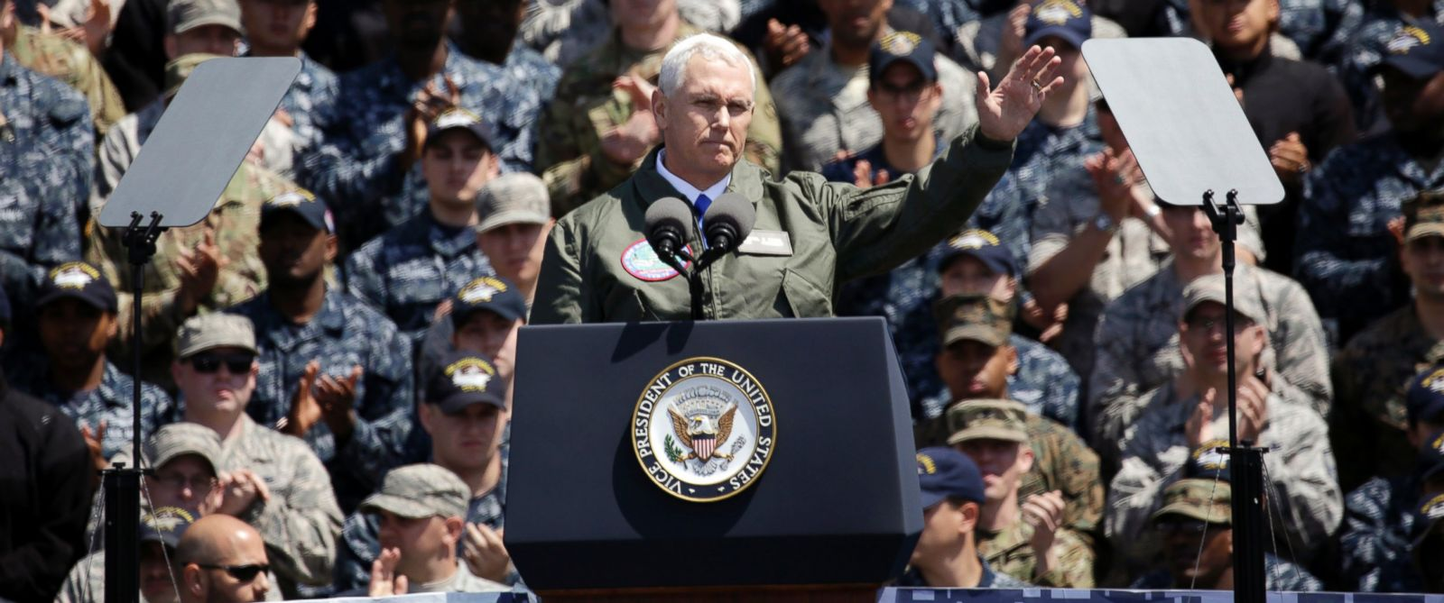 PHOTO: U.S. Vice President Mike Pence, front, waves to U.S. servicemen and Japanese Self-Defense Forces personnel on the flight deck of U.S. navy nuclear-powered aircraft carrier USS Ronald Reagan, at the U.S. Navys Yokosuka base, south of Tokyo.