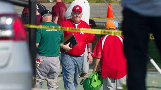 PHOTO: Rep. Joe Barton, center, and other members of the Republican Congressional softball team, stand behind police tape of the scene of a multiple shooting in Alexandria, Va., June 14, 2017, where House Majority Whip Steve Scalise of La. was shot.