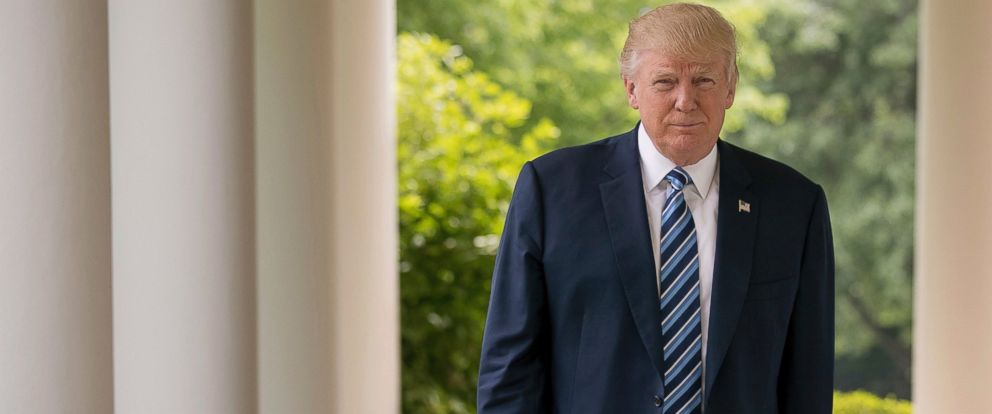 PHOTO: President Donald Trump walks along the West Wing Colonnade at the White House in Washington, April 21, 2017.