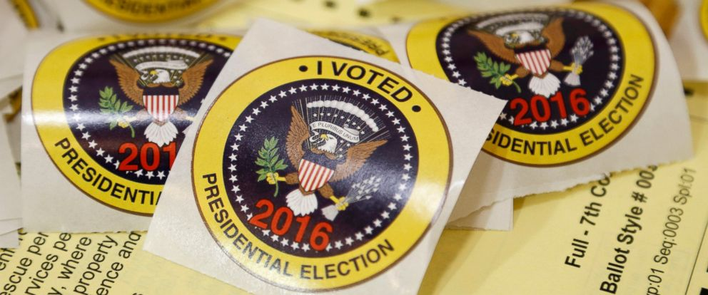 PHOTO: I voted stickers rest on a sample ballot ready for voters at a polling place in Richmond, Va., Nov. 8, 2016.