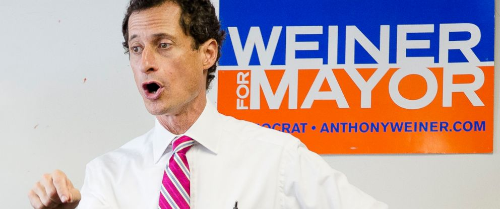 PHOTO: In this July 29, 2013, file photo, New York City mayoral candidate Anthony Weiner talks to voters in the Queens borough of New York.