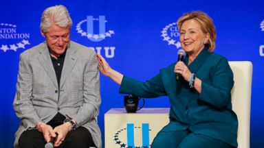 PHOTO: Bill Clinton, left, listens as Hillary Rodham Clinton speaks during a student conference for the Clinton Global Initiative University at Arizona State University in Tempe, Ariz. in this March 22, 2014 file photo.