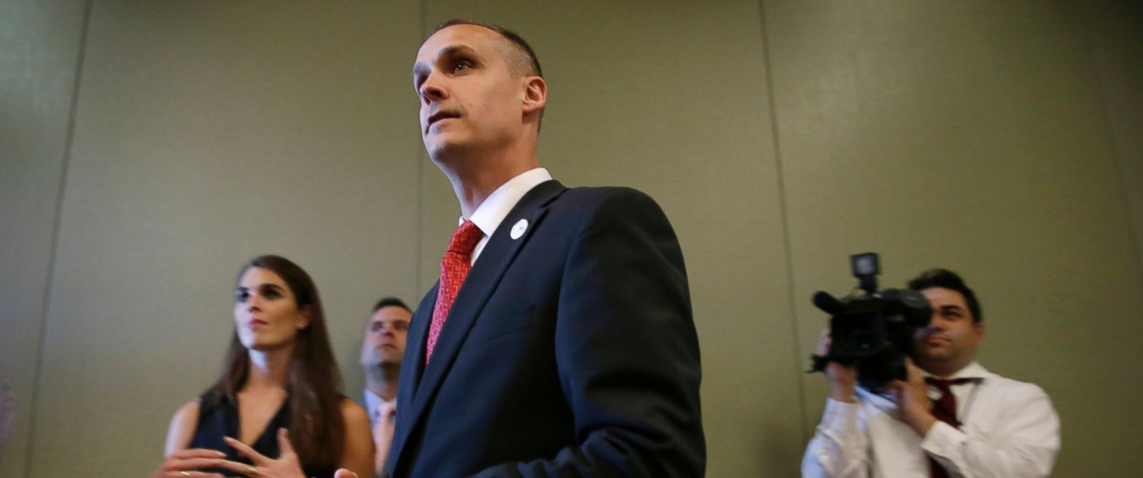 PHOTO: Campaign manager Corey Lewandowski, center, looks on as Republican presidential candidate Donald Trump speaks at a news conference on Aug. 25, 2015, in Dubuque, Iowa.