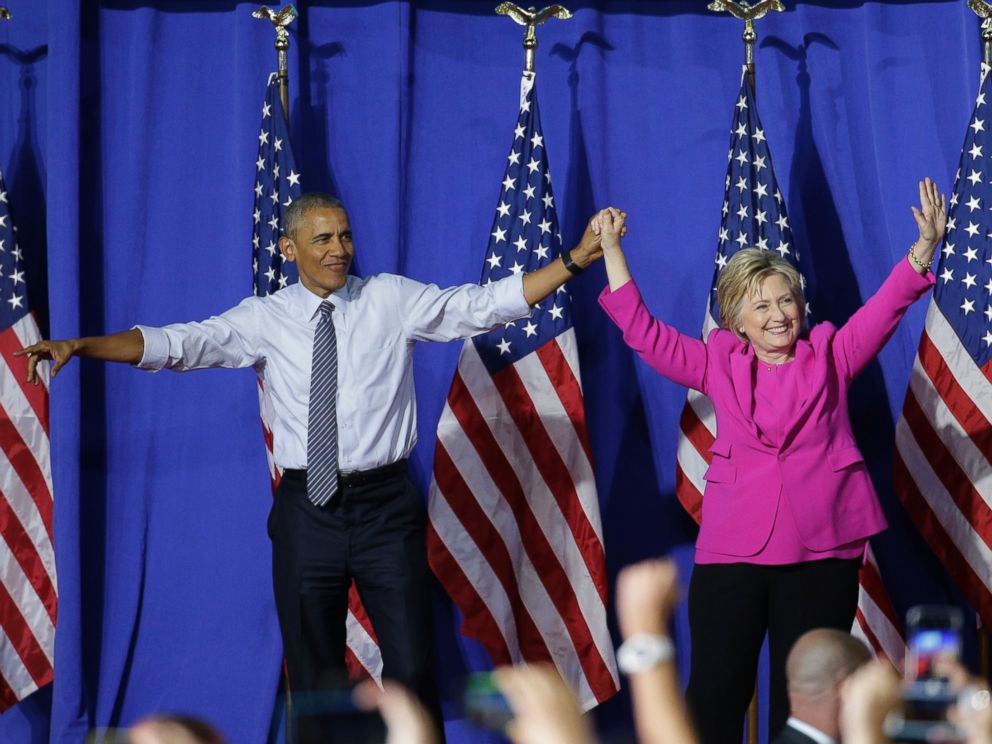 PHOTO: President Barack Obama and Democratic presidential candidate Hillary Clinton wave to the crowd during a campaign rally for Clinton in Charlotte, North Carolina, July 5, 2016.