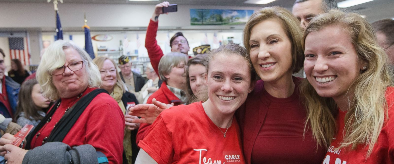 PHOTO: Republican presidential candidate, businesswoman Carly Fiorina has a selfie taken with supporters during a campaign stop at Hollis Pharmacy, Friday, Jan. 15, 2016, in Hollis, N.H.