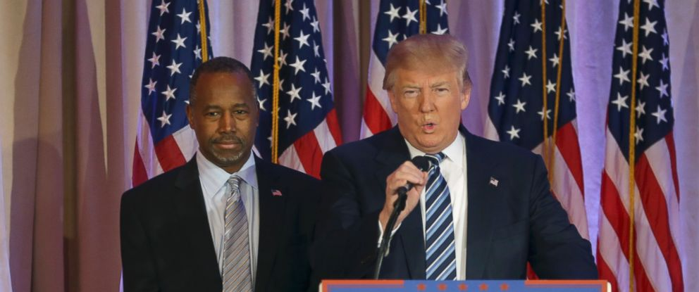 PHOTO: Former Republican presidential candidate Ben Carson listens at left, before announcing he will endorse Republican presidential candidate Donald Trump during a news conference at the Mar-A-Lago Club on March 11, 2016, in Palm Beach, Fla.