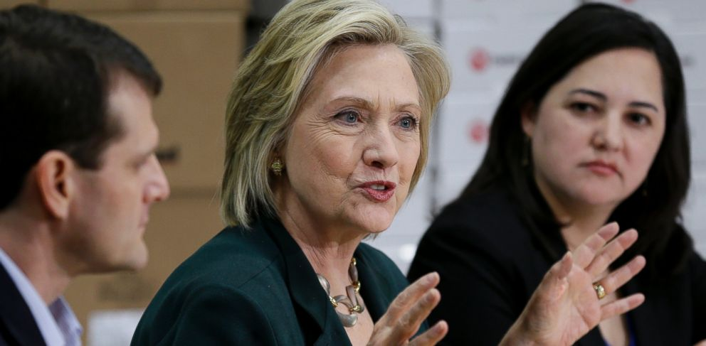 PHOTO: Democratic presidential candidate Hillary Rodham Clinton, center, speaks during a small business roundtable, Wednesday, April 15, 2015, in Norwalk, Iowa.