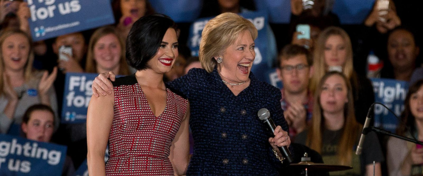 PHOTO: Democratic presidential candidate Hillary Clinton, right, and musician Demi Lovato acknowledge the cheering crowd at a rally on the campus of University of Iowa Thursday, Jan. 21, 2016, in Iowa City, Iowa.