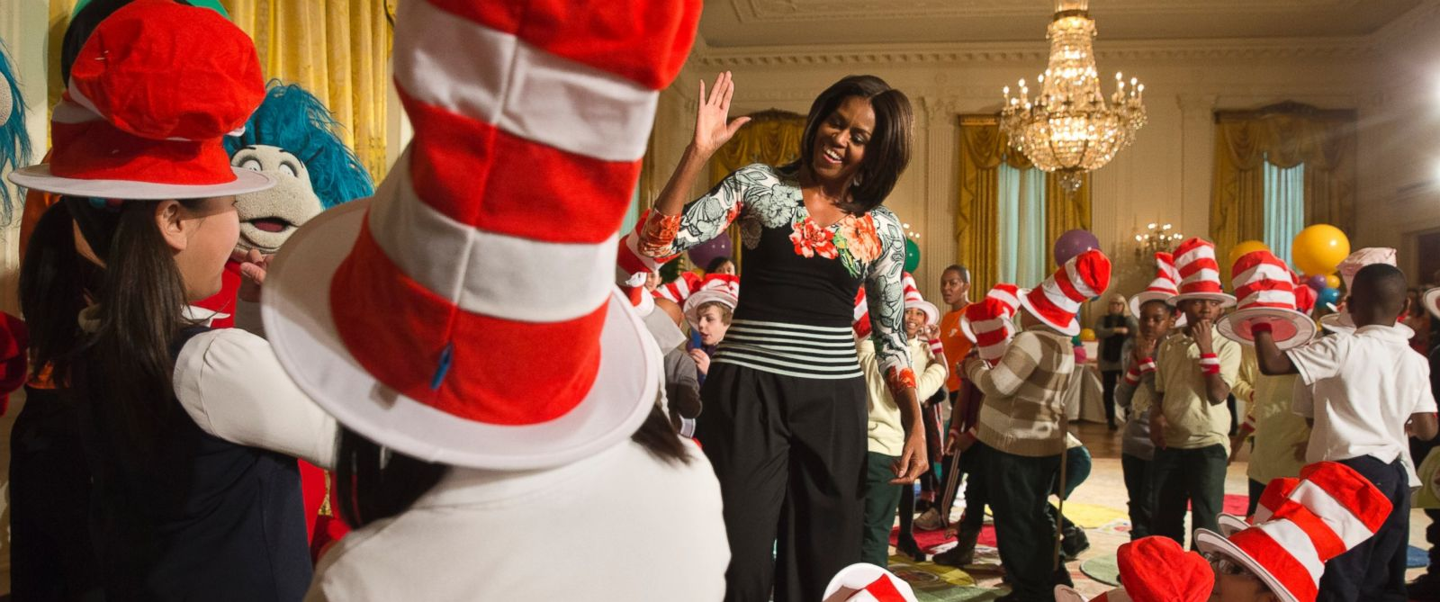 "PHOTO: First lady Michelle Obama greets local students after reading to them as part of her ""Lets Move, Lets Read!"" initiative, Wednesday, Jan. 21, 2015, in the East Room of the White House in Washington."
