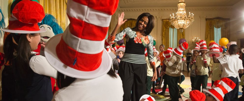 """PHOTO: First lady Michelle Obama greets local students after reading to them as part of her """"Lets Move, Lets Read!"""" initiative, Wednesday, Jan. 21, 2015, in the East Room of the White House in Washington."""