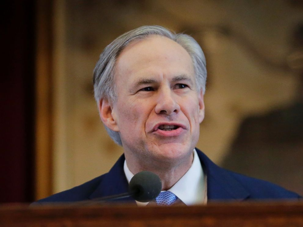 PHOTO: Texas Gov. Greg Abbott holds a book about Texas school laws as he delivers his State of the State address to a joint session of the House and Senate, Tuesday, Feb. 17, 2015, in Austin, Texas.