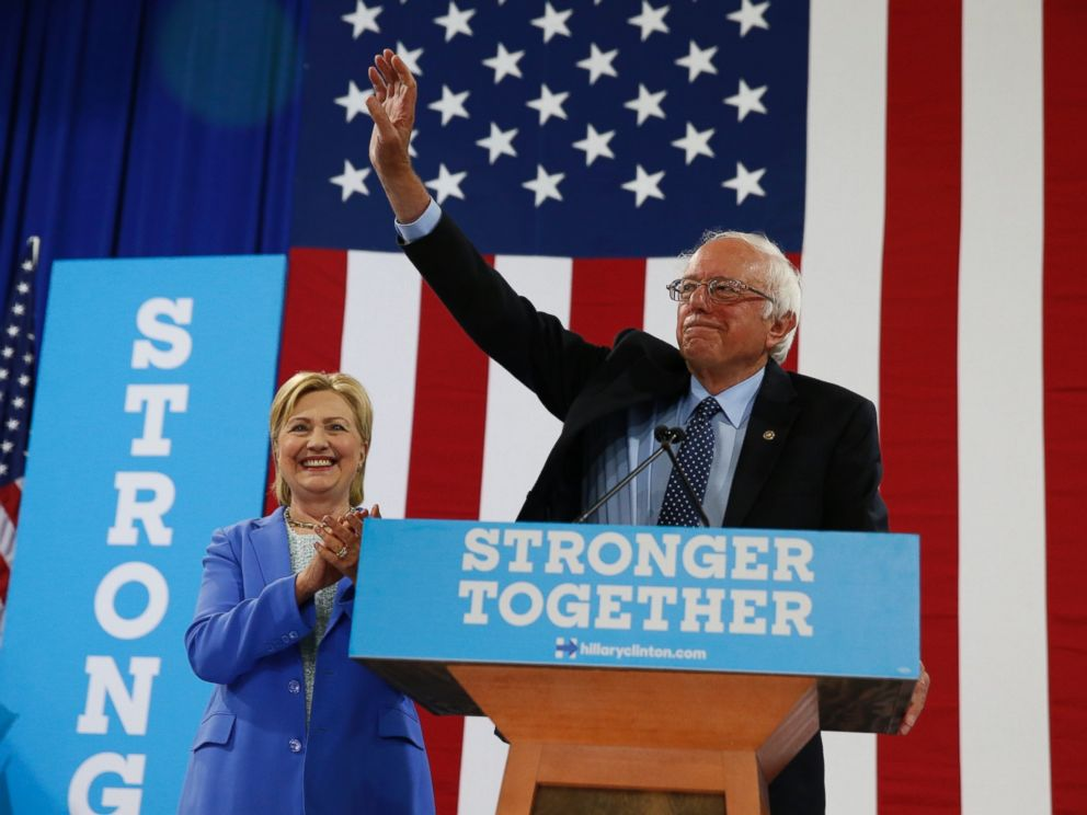 PHOTO: Sen. Bernie Sanders waves as he and Democratic presidential candidate Hillary Clinton arrive for a rally in Portsmouth, New Hampshire, July 12, 2016.