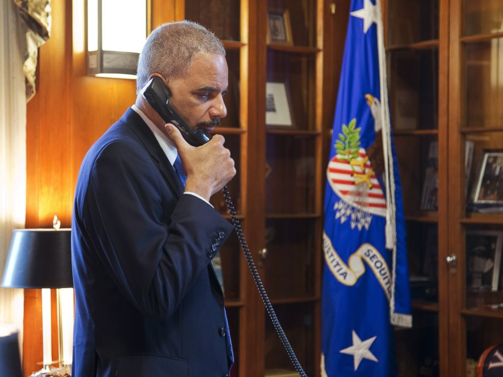 PHOTO: Attorney General Eric Holder makes calls related to the situation in Ferguson in his office at the Department of Justice in Washington, Nov. 25, 2014.