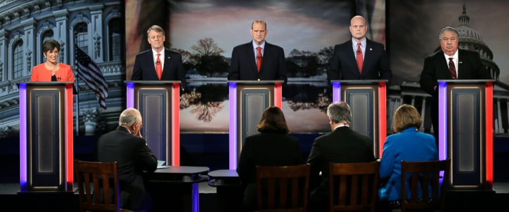 PHOTO: Iowa Republican senatorial candidates, from left, State Sen. Joni Ernst, Mark Jacobs, Schaben, Matt Whitaker and Sam Clovis stand on stage during a live televised debate at Iowa Public Television studios, April 24, 2014, in Johnston, Iowa.