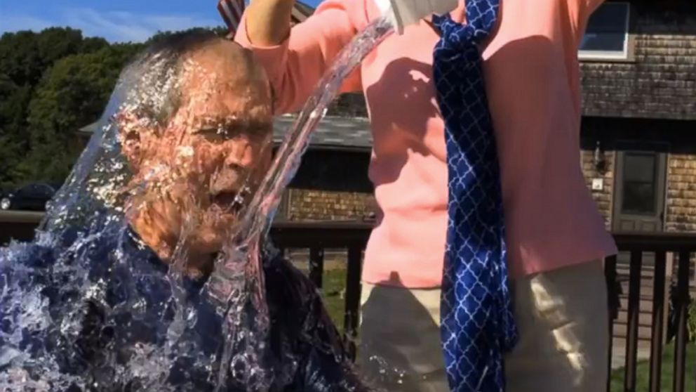 In this image from video posted on Facebook, courtesy of the George W. Bush Presidential Center, former President George W. Bush participates in the ice bucket challenge with the help of his wife, Laura Bush, in Kennebunkport, Maine.