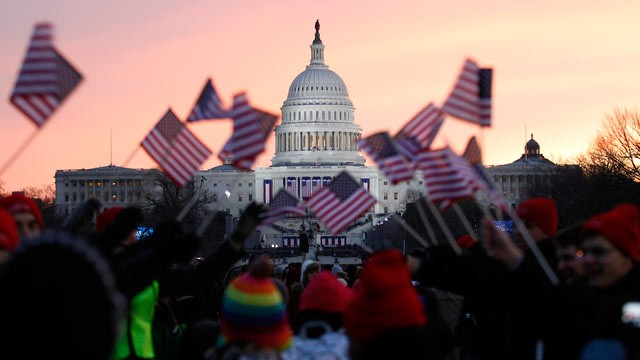 PHOTO: President Barack Obama supporters wave American flags on the National Mall in Washington, Jan. 21, 2013, prior to the start of President Barack Obama's ceremonial swearing-in ceremony during the 57th Presidential Inauguration.