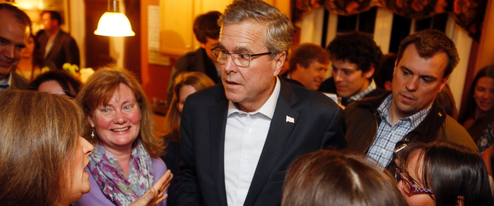 Florida Gov. Jeb Bush speaks with area residents at a packed house party Friday, March 13, 2015, in Dover, N.H.